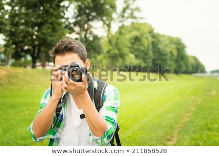 Young Man Taking A Photography With An SLR Camera Stock photo © Jasminko