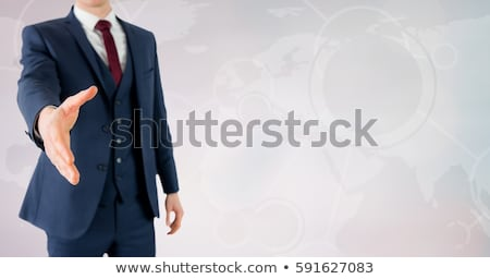 Businessman with outstretched hand Stock photo © cherezoff