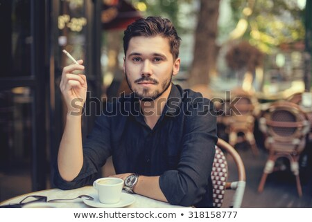 Attractive Bearded Man Smoking on the Street  Stock photo © dariazu