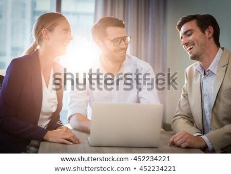 businessmen and businesswoman interacting using laptop stock photo © wavebreak_media