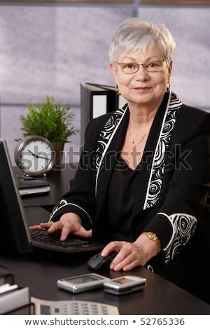 Gray suit business women_desk work Stock photo © toyotoyo