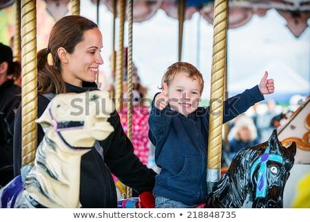 mom and son having fun at an amusement park stock photo © galitskaya