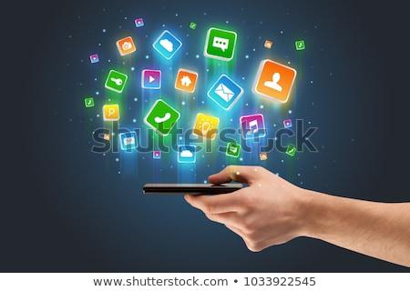 Kéz telefon alkalmazás ikonok repülés körül Stock fotó © ra2studio