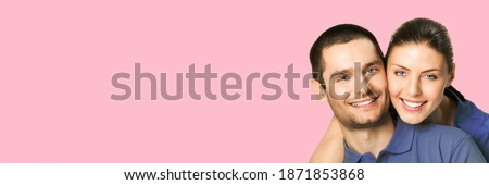 Smiling beautiful young woman posing isolated over pink background take care of her skin holding cos Stock photo © deandrobot
