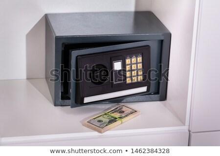 Bankjegyek elöl elektronikus öltözőszekrény közelkép biztonság Stock fotó © AndreyPopov
