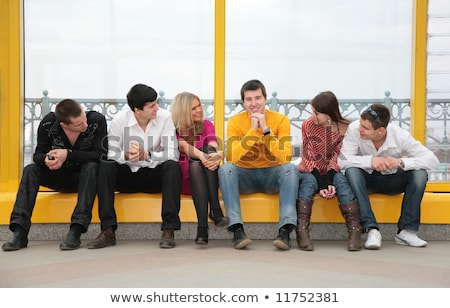 group of young persons sit on footbridge Stock photo © Paha_L