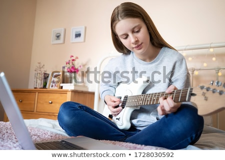 Girl with electric guitar in bedroom Stock photo © photography33