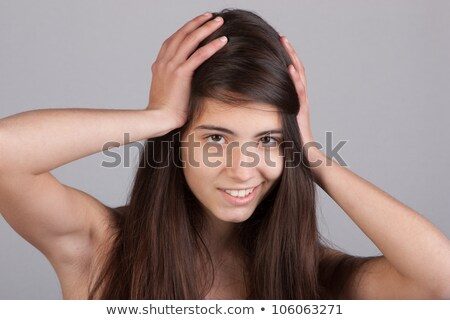 Pretty woman with ands at her head  Stock photo © pedromonteiro