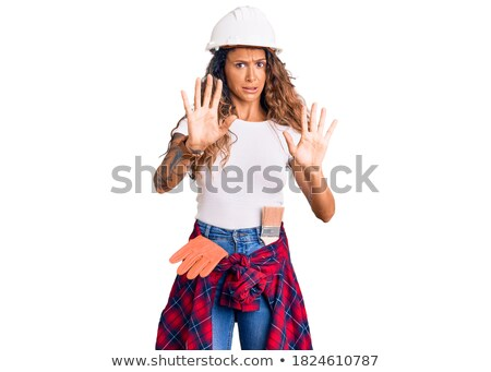 A horrified female construction worker. Stock photo © photography33