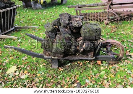 wheelbarrow with peat Stock photo © compuinfoto