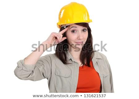 Tradeswoman giving a salute Stock photo © photography33
