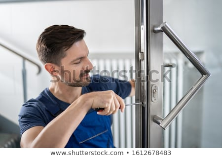 Manual worker fitting door Stock photo © photography33