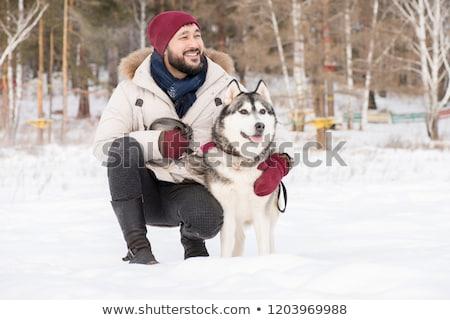 Man walking with dog in snow Stock photo © ivonnewierink