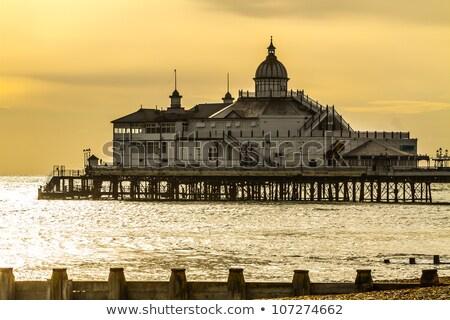 Pier plage nuages coucher du soleil paysage Voyage Photo stock © arturasker
