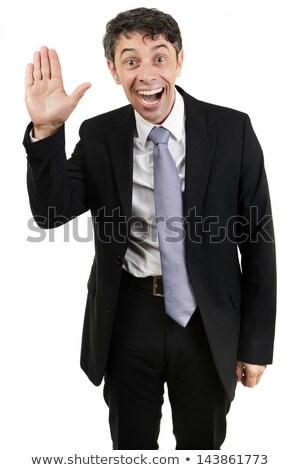 Quirky businessman waving hello Stock photo © smithore