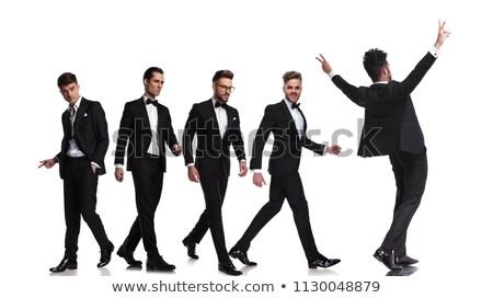 Elegáns férfi csokornyakkendő tart egy kéz Stock fotó © feedough