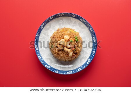 Fried rice with seafood. Asian cuisine. Stock photo © dariazu