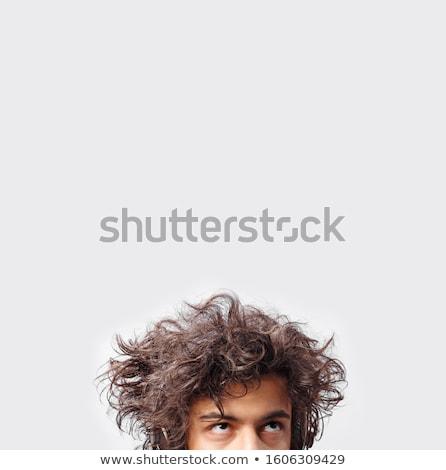 Portre yakışıklı adam dağınık saç stüdyo poz Stok fotoğraf © feedough