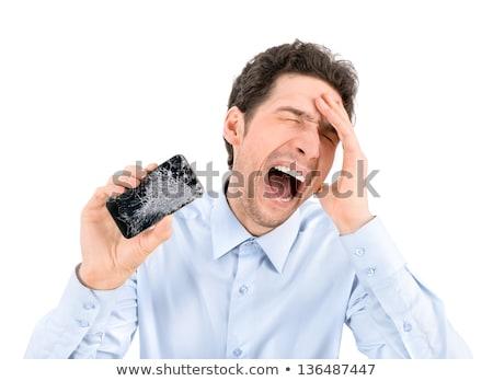 Arrabbiato pazza giovani imprenditore cellulare Foto d'archivio © deandrobot