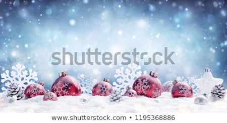 Stock photo: Christmas Bauble on a Snowflake Background Card