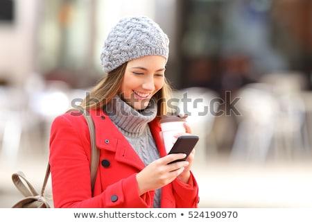 Sending SMS messages on mobile phone in autumn Stock photo © stevanovicigor