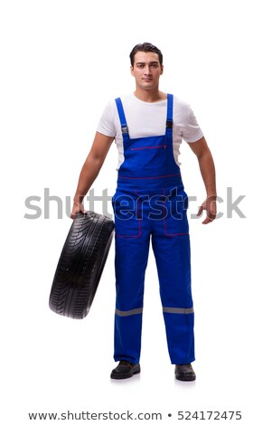 Handsome tyre repairman isolated on white Stock photo © Elnur
