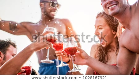 Happy young friends having exclusive boat party in caribbean sea Stock photo © DisobeyArt