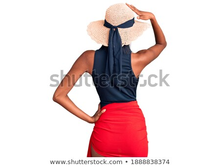 portrait of woman in swimsuit with hand on head looking away on white, body care concept Stock photo © LightFieldStudios