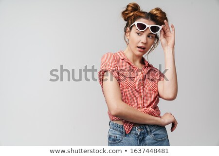 shocked teenage girl in eyeglasses looking away isolated on white Stock photo © LightFieldStudios