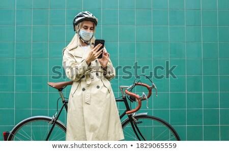 White coat women_road bike Stock photo © toyotoyo