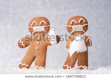 Christmas greeting card with gingerbread cookie Stock photo © karandaev