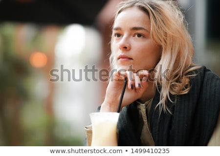 Pensativo mulher jovem preto blusa jeans posando Foto stock © acidgrey