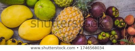 BANNER, Long Format Colorful fruits on the white wooden table, Bananas, carambola, mango, papaya, ma stock photo © galitskaya