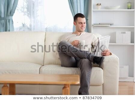 Adam okuma gazete kahve oturma odası ev Stok fotoğraf © wavebreak_media
