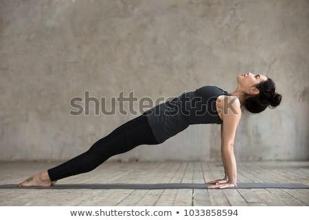 Woman doing Hatha yoga asana Purvottanasana Stock photo © dmitry_rukhlenko