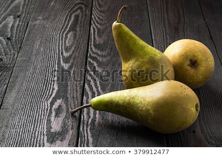 three pears on wooden background stock photo © elly_l