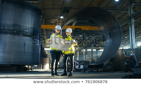 construction worker and an engineer looking at a drawing stock photo © photography33