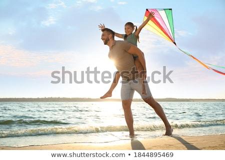 girl flying a kite at the beach stock photo © arenacreative