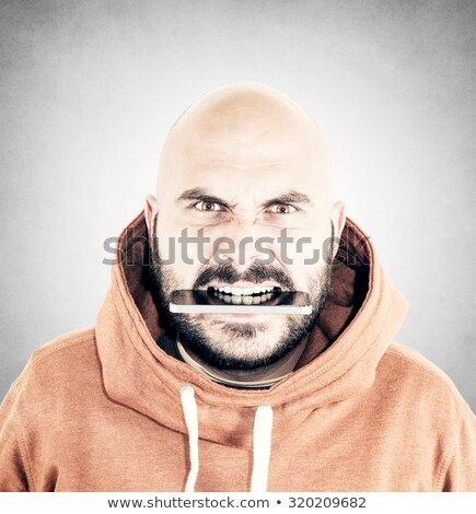 Bald man shouting into two telephones Stock photo © photography33