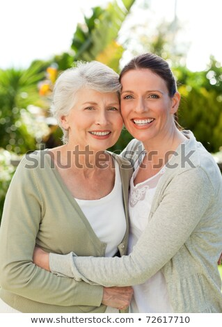 Mother with her daughter looking at the camera in the garden Stock photo © wavebreak_media