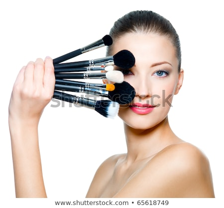 beautiful woman holding make up brushes stock photo © photography33