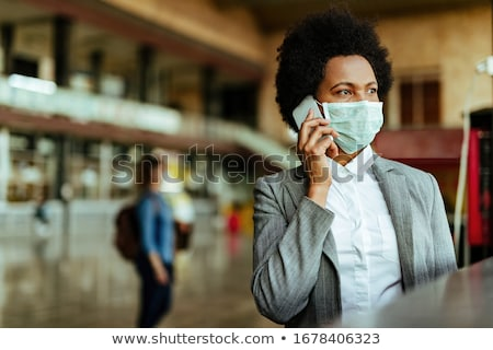 An African American businesswoman over the phone. stock photo © photography33