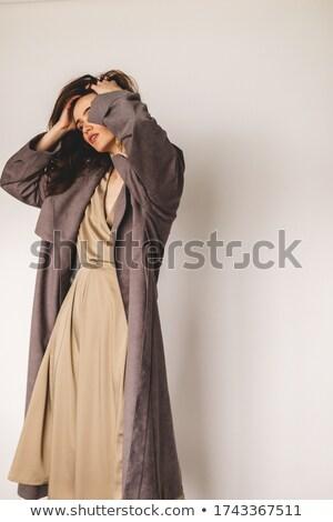 fashion woman fixing her coat stock photo © feedough