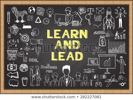 Learn and Lead Concept Hand Drawn on Chalkboard. Stock photo © tashatuvango
