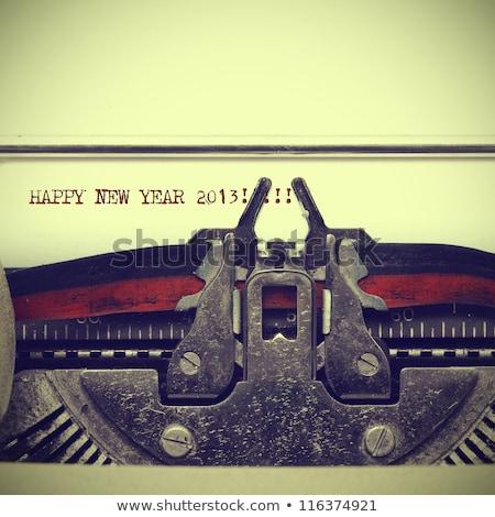 happy new year on old typewriter stock photo © stevanovicigor