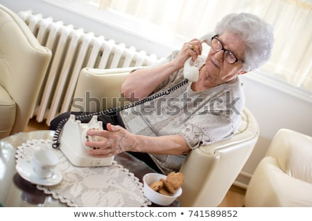 Grandmother talking on a retro rotary phone Stock photo © ozgur