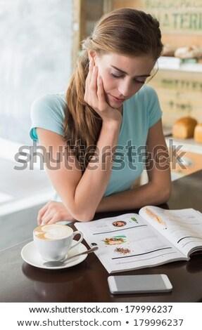 woman reading magazine in a bar stock photo © deyangeorgiev