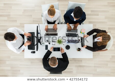 high angle view of businessman working on laptop stock photo © wavebreak_media
