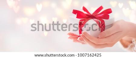 Woman holding small red gift box Stock photo © Lana_M