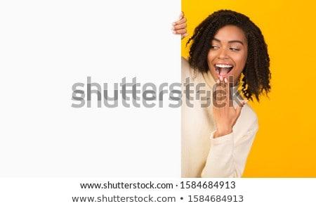 Woman Peeking Behind Stock photo © filipw